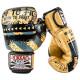 Боксёрские перчатки YOKKAO Hustle Muay Thai gold/black (01645)